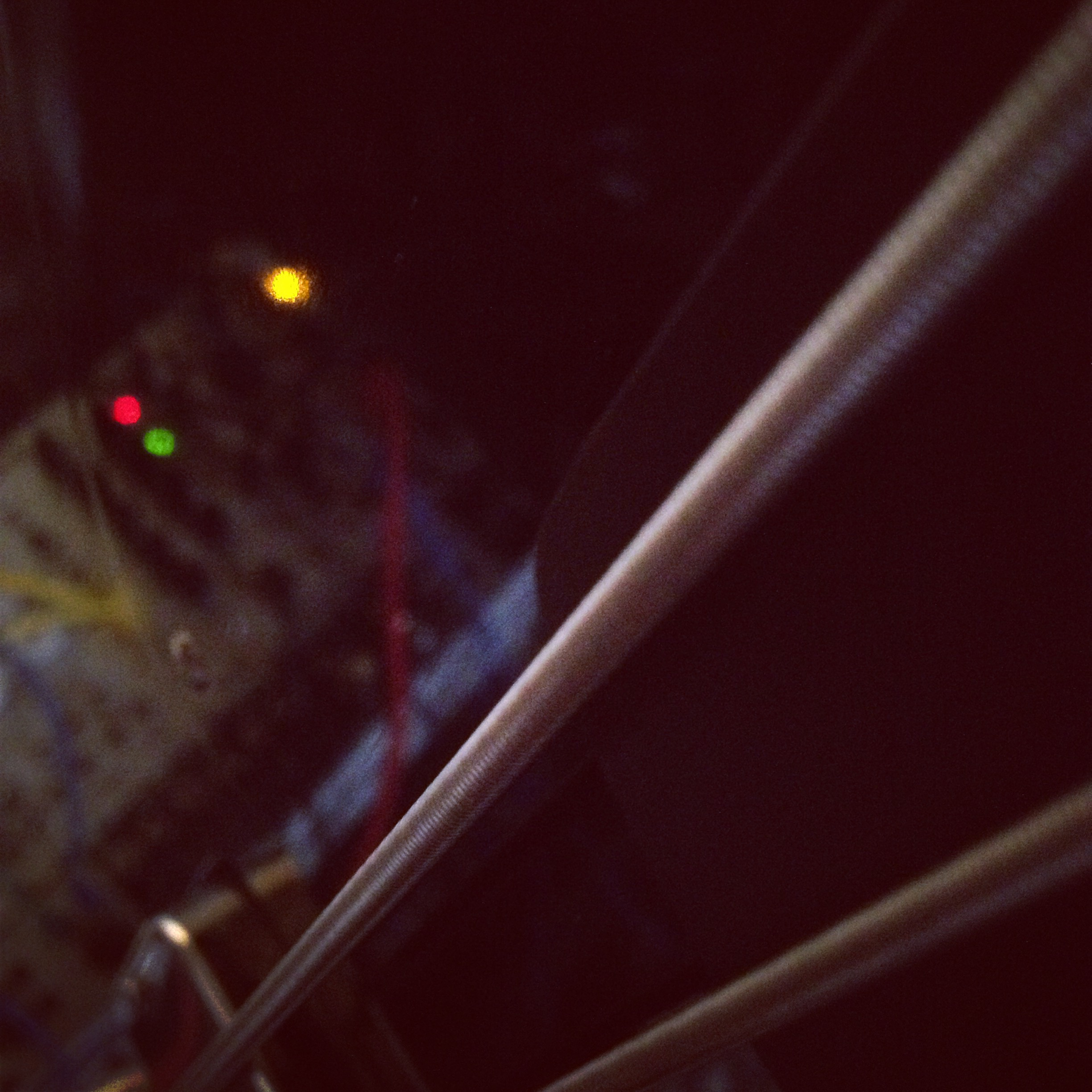 Modular synth reflected in the Creston fretless